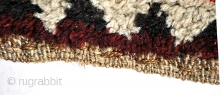 Gabbeh, 100 x 210 Cm. Mostly with naturual undyed wool of sheep en camels.  Reds and blue are dyed.  Great natural abrash.  70-ties.