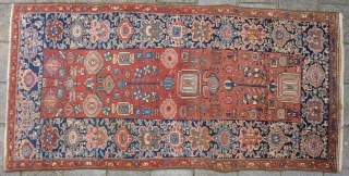 Antique NW Persian Kurdish Kelleh 244 x 121 cm., ca. 1910, with 3 small spots with foundation visible and 3 tiny spots with mothing, sides rewrapped. Endings secured.