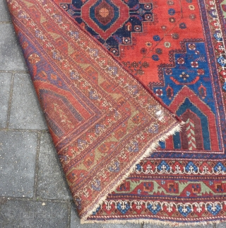 """Afshar rug, ca. 1920, 211  x 161 cm., 6'11"""" x 5'3"""". In general good pile with original sides and endings. Corroded browns, a bit of lower pile at the central part  ..."""