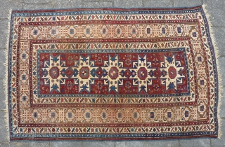 "Antique Kuba Lesghi with Kufic border, 204  x 131 cm., 6'8"" x 4'4"", ca. 1900. Good pile with corroded browns and some scattered wear. In the center three repaired slits and  ..."