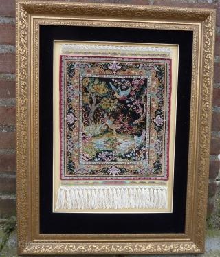 Fine 15 x 15 knts. p/cm. silk on silk Hereke, signed Özipek in its original frame, Seize frame:  60  x 47 cm., Seize rug: 34  x 26 cm. Mint  ...