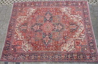 """Heriz 378 x 299 cm., 12'5"""" x 9'9"""" , with some wear around the center. Heavy and tightly knotted piece, 52 kgs."""