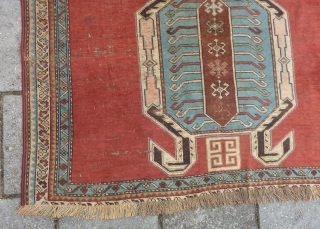 Caucasian Lenkoran, end of 19th cent., 170 x 118 cm. Missing outer guard border; natural dyes and a faded pinkish red.