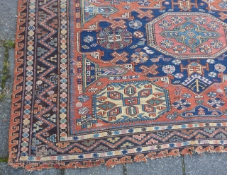 """Dated Kuba Sumakh 1877 ( 1294 ), 280 x 198 cm., 9' 2"""" x  6' 6"""". With patches, damages and lots of joyfully used faded early fuchsine dye."""