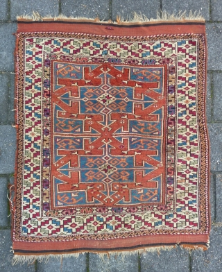 "Bergama, 134  x 114 cm., 4' 5"" x 3' 9"", mid 19th c., with lots of cochenille in the border. Nice positive-negative reciprocity. Sides redone, two little holes, one tiny repair.  ..."