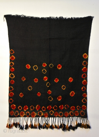 Tunisian Berber woman's veil. Dark indigo almost black with tie dye motifs in orange, blood red, and indigo