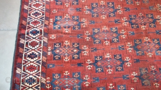 "#7373 Antique Yomud Bohkara Rug This circa 1890 Yomud Bohkara measures 6'2"" x 10'7"" ( 188 x 326 cm). It has a mahogany colored field covered in Kepsi guls in various shades of  ..."