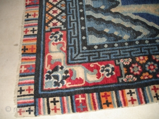 """#6699 Tibetan Rug  This Tibetan rug measures 8'2"""" x 5'4"""" (249 x 164 cm). It contains a Khotanesque design of geometric chrysanthemum, lotus and peony blossoms sprouting from a rockery with a water  ..."""