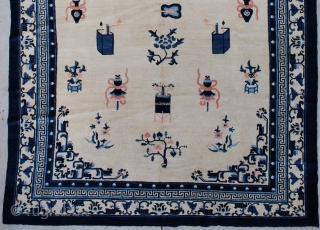 """#7263 Antique Peking Chinese Rug  This circa 1900 Peking Chinese Oriental carpet measures 7'2"""" x 12'1"""". It has an ivory field containing various Buddhist iconographies including the beribboned umbrella, paint boxes, standing  ..."""