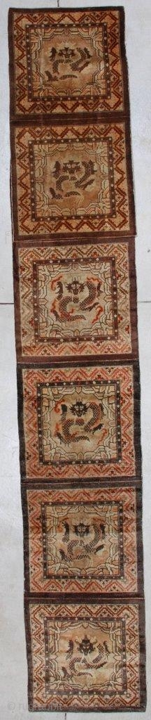"""#7151 Antique Tibetan Meditation Rug This late 19th century Tibetan Meditation runner measures 2'3"""" x 20'3"""" (70 x 617 cm ). This rug has been folded over for purposes of taking the photograph  ..."""