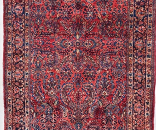 """This circa 1920 Sarouk Persian Oriental Rug #7847 measures 4'4"""" X 6'8"""". It is a deep ruby red with an overall floral design which is very crowded and very beautiful. The field  ..."""