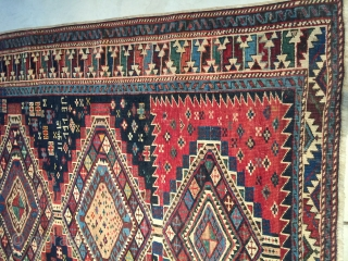 """This antique Shirvan #7853 dated 1913 in five places measures 4'0"""" X 5'9"""". The field of the rug is divided into thirds. The top and bottom third have a red ground. The  ..."""