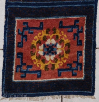 """#7197 Ningxia Runner  This late 19th century Ningxia runner measures 2'1' X 17'8"""". It is comprised of nine meditation squares in burnt sienna with Chinese fretwork in the corners and a wreath of  ..."""