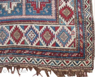 #6423 Shirvan Antique Caucasian Rug This circa 1870 Shirvan antique Oriental rug measures 4'0' X 6'0'. It has fifteen panels with red and white medallions containing cross bars of ivory/blue , ivory/red  ...