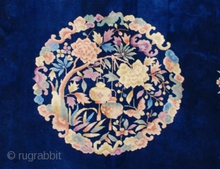 "This circa 1930  Chinese Tien Sing weave Peking motif rug measures 10'0"" x 13'7"". It has a deep royal blue background with urns filled with floral sprays, bowls of fruit. It has  ..."