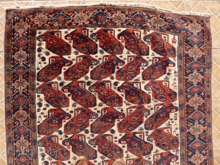 White Ground 'Mother and Child'  Boteh Afshar Rug, 185 x 135 cm. circa 1900 Good condition with a central vertical folding line and a central weak spot. Original side cords that need  ...