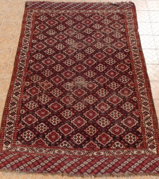 Chaudor/ Chodor Main Carpet, 11ft x 7.7ft. (335 x 235 cm.) late 19 th. century. Characteristic Ertmen Gol design on dark purple-brown ground. SOLD!