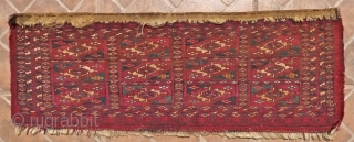 Tekke Mafrash, 72 x 26 cm. 19 th. Cent.  The design with 12 Tekke Chuval Gols. Pink silk and white cotton accentuations. Fine weave (circa 5,300 knots per sq. dm.) No  ...