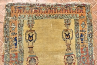An 'Hadji Jalili'  Tabriz Prayer Rug, 175 x117 cm. (5.75ft x3.8ft.) NW Persian. Circa 1850.  This extraordinary rug, only shows the basic design features of border and coupled columns. It  ...