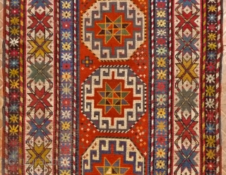 Karabagh long rug,  10ft x 3.9ft (305 cm x 120 cm.) Late 19 th. century.. The design with a single, vertical row of Moghan Memling Guls. Attractice white ground border with  ...