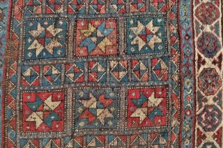 A Genje long rug with star design, late 19 th. century, 