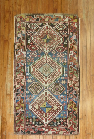 Antique Kazak. Size 3'x5' both ends missing its teeth border.  Gorgeous blue field containing an abrash.