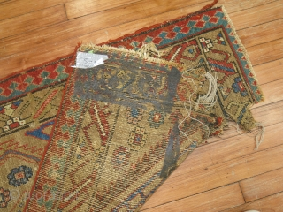 Antique Bakhshaish 2'6''x9'8''.  Very old piece. Top end is cracking from glue..  its about 6 inches from top to bottom.  I believe it has been reduced or a slit  ...