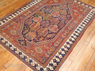 Antique Afhasr rug.  Size 4'2''x6'.  Some low areas.  Highly artistic.