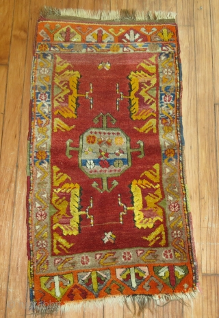 Decorative Antique Turkish Yastik.  1'8''x3'.  ONe end minimal missing.