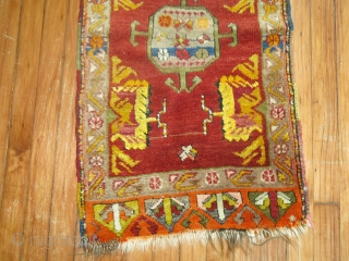 Decorative Antique Turkish Yastik.  1'8''x3'.  ONe end minimal missing. Some synthetic color