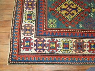 Antique Kazak 3'5''x6'2''.  Excellent condition.  Bought as is.  May have been professionally repaired.  Hard for me to tell.