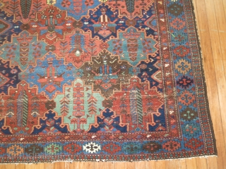 Antique Persian Bakhtiar Size 5'2''x7'2''.  Good size, nice colors good condition.  Sides and ends need a little attention.  field also needs a little love.