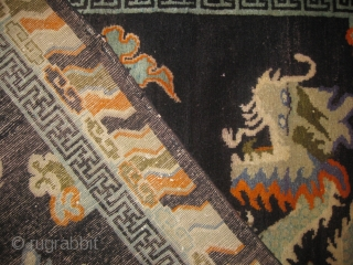 An old double dragon Tibetan rug in mint condition no repair measuring 6.8 x 4.5 ft.