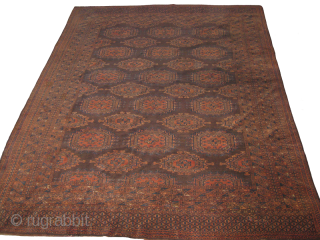 An early 20th century fine Turkoman Sarooq, re-paired on some areas, size: 9 x 6.6 ft.