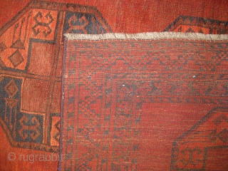 An old Turkmen carpet in mint condition measuring 12 x 9 feet.