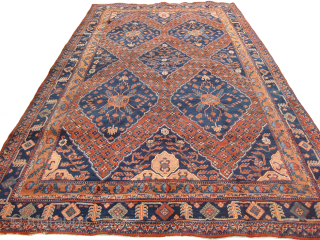 An old Khotan in mint condition measuring 14 x 7 feet.