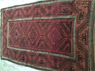 Baluch rug in mint condition measuring 6 x 4 feet approximately.