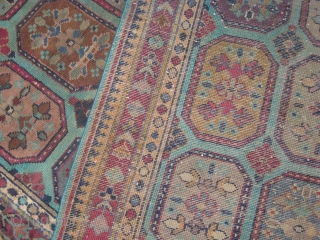 An old Indian Carpet measuring 9 x 5.8 ft, consistent wear with age and use.