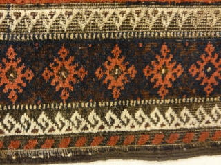 An antique and original burial Baluch dated rug. Dated on all four corners. Used as a casket covering. Sold by Santa Barbara Design Center. Finest Tribal Baluch rugs can be primarily recognized  ...