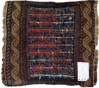 Fascinating antique Kelat bagface from Northeast of Iran.  This is a double technique weave with a very fine flat weave in the centre and piled technique on either end. There are  ...