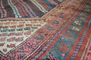 Delightful antique Kordi rug from West of Iran. There is a small area of repair, which has been expertly repaired, otherwise very good even low pile. 171x142cm