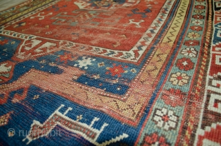 Antique Kazak rug 157x108cm, Circa 1900. Soft colours, in relatively good condition, in need of some attention.
