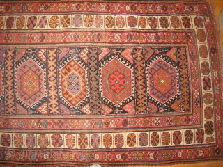 An uncommon Kurdish Long Rug with 11 or so medallions.