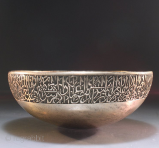 A Mughal Deccan bronze calligraphic bowl, India, Golconda or Bidar, 16th century of squat round bowl form, an engraved Arabic calligraphic around the bowl, the spherical base encircled by a splayed ridge,  ...