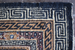 Antique Inner Mongolian rug  with sign of use and corrosion lattice field design yellow ,plum purple,indigo blue,cream and camel brown meandering line border indigo dark blue & yellow size 350 cm x 250  ...