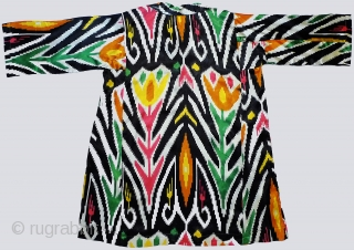 "Faux-Ikat Silk Dress. Uzbekistan, 3rd quarter 20th century. Machine-printed ikat with unusual tulip pattern on heavy-weight silk sateen. Unlined; machine-embroidery around neck opening. 41"" shoulder to hem; 61"" cuff to cuff. Cut  ..."