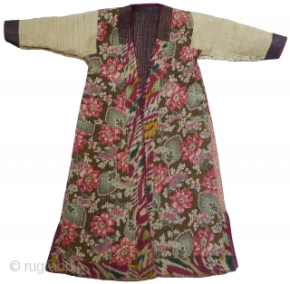 Khorezm Robe. Khiva Khanate, Uzbekistan, late 19th century. All original. Handwoven cotton alacha with a polished finish. Body lined with beautiful Russian printed cotton; sleeves lined with handwoven cotton; adras ikat facings;  ...
