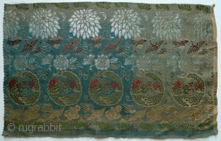 "Vintage Japanese Silk Brocades. 1. Partial obi with small pattern of dragons, pine boughs and flowers (see detail photo), 121"" x 9.5"", (one finished end, fabric in excellent condition); 2. Bird in  ..."