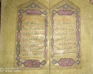 Quran manuscript having 50 illuminated pages with lacquered binding .