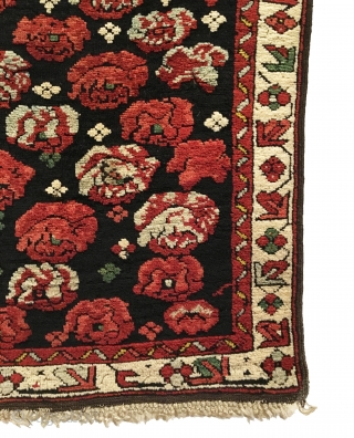 Antique Caucasian Seychour Cabbage Dowry Rug. 3rd Quarter 19th Century. Cabbage heads float on dark brown field. Attractive floral meander border accentuates the field design. All four sides original with macramé end  ...